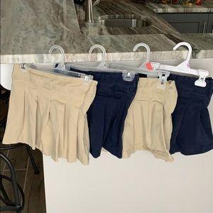 Bundle of four girls TCP uniform skirts. Size 6.